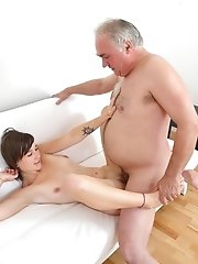 It doesn't look like he's quite done with her pert little titties, but he simply can't help himself when it comes to that pussy. It